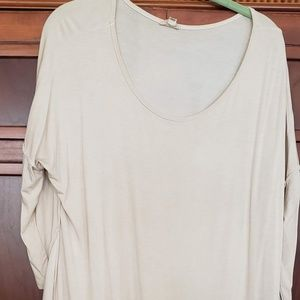 cream colored tunic with exposed seams